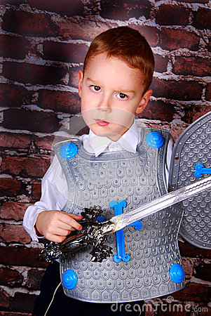 Little boy dressed as a knight