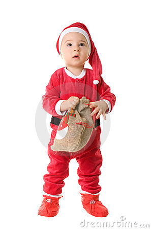 A little boy dressed as Santa Claus.