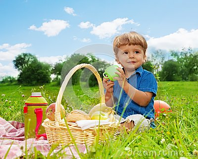 Little boy drinking on picnic