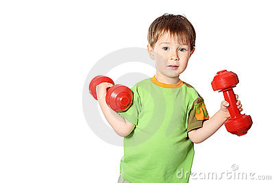 Little boy with dumbbells