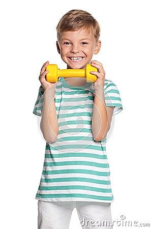 Little boy with dumbbells