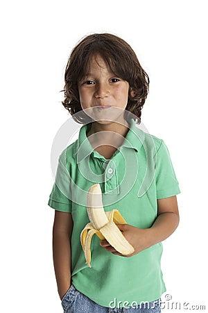 Little boy eating a banana