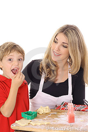 Little boy eating cookie batter