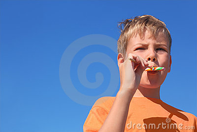 Little boy eating multicolored lollipop