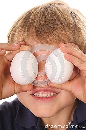 Little boy with egg eyes vertical