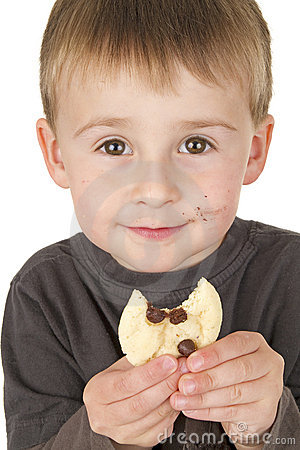 Little boy enjoys eating cookie