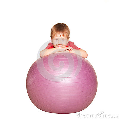 Little boy with the fitness ball.