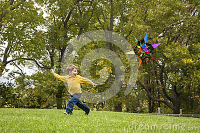 Young child flying a kite