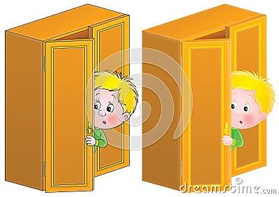 Little boy in fright is hiding in the dresser