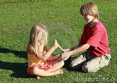 Little boy and girl changing money