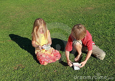 Little boy and girl counting money