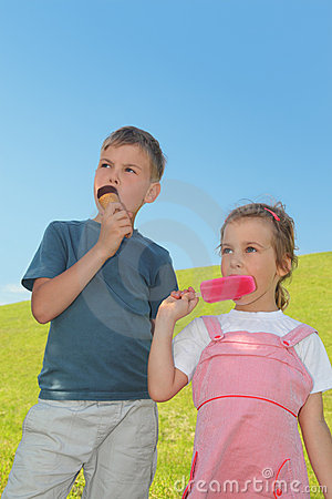 Little boy and girl eating ice-creams Stock Photo