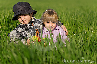 Little boy and girl in field