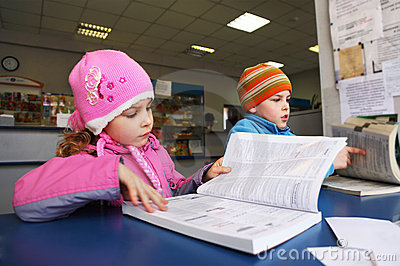 Little boy and girl reading book