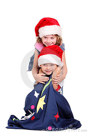Little boy and girl in Santa Claus hats