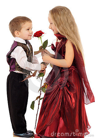 Little boy gives a girl a rose