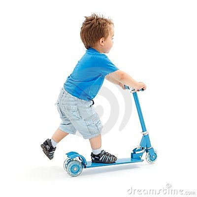 Little boy going with scooter