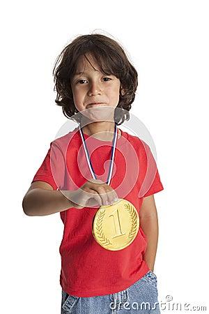 Little boy with a golden medal