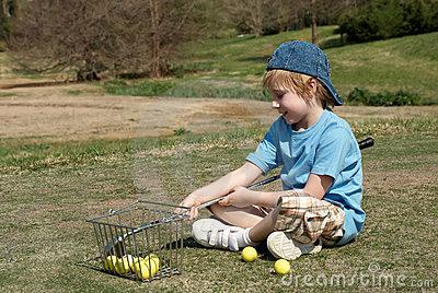 Little boy on a golf field
