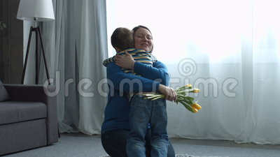 Little boy greeting his mother on Mother`s day stock video footage