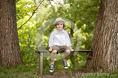 Little boy in a hat, shorts