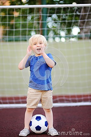 Free Little Boy Having Fun Playing A Soccer/football Game On Summer Day Royalty Free Stock Photo - 104717785