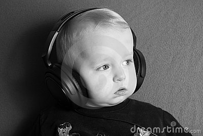 A little boy with headphones looking