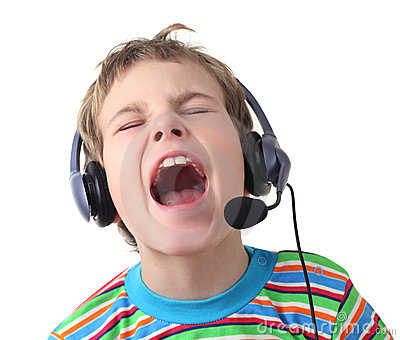 Little boy with headphones and microphone singing