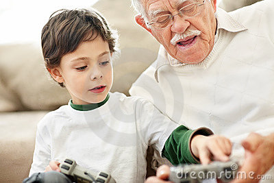 Little boy helping his grandfather