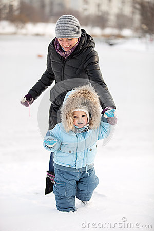 Little boy and his mom having fun on a winter day