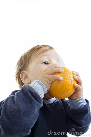 Little boy hold a orange.