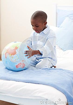 Free Little Boy Holding A Terrestrial Globe Stock Image - 12684281