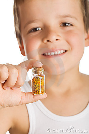 Little boy holding bottle of pollen