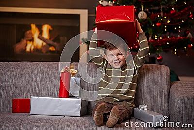 Little boy holding christmas present
