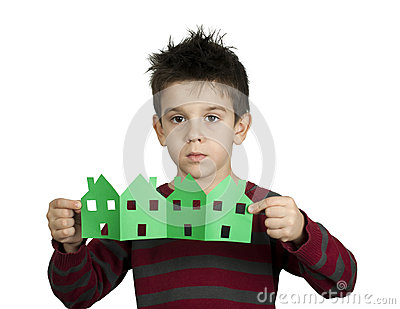 Little boy holding houses made ​​of paper
