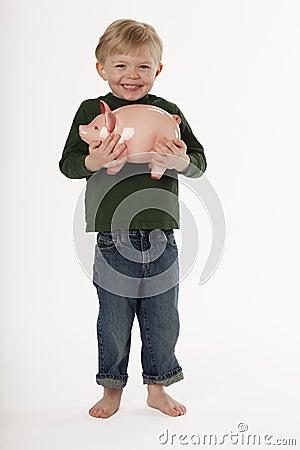 Little Boy Holding a Piggy Bank