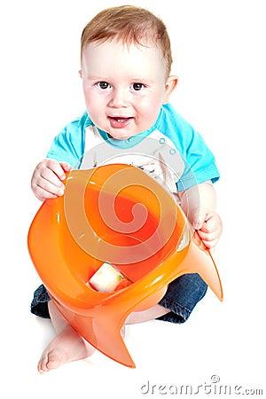Little boy holding potty