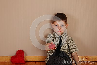 Little Boy Holding a read Heart