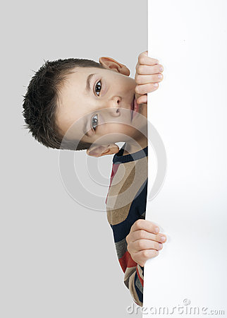 Little boy holding a whiteboard