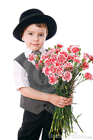 Little boy holds a bouquet of carnations
