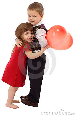 Little boy hugging girl with red balloon