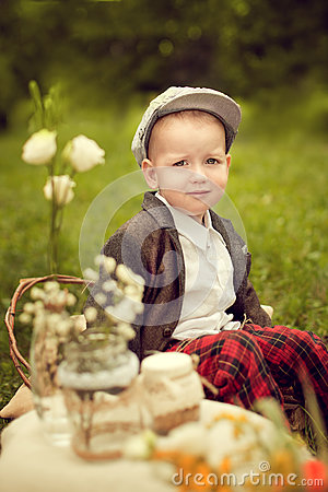 Free Little Boy In A Jacket And Plaid Pants To Sit On The Cushion, Ne Royalty Free Stock Images - 76217799