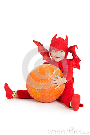 Free Little Boy In Red Devil Costume Sitting And Holding Big Pumpkin Royalty Free Stock Image - 33954386