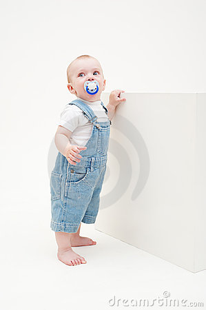 Little boy in jean dungarees