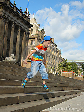 Little boy jumping from town-hall steps