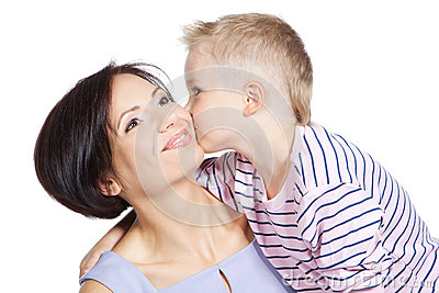 Little boy kissing beautiful mother over white