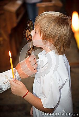 The little boy a kissing cross