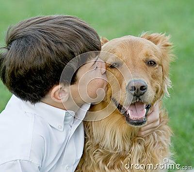 Free Little Boy Kissing Dog Royalty Free Stock Photos - 5869648