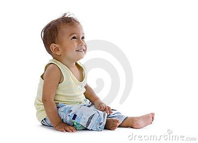 Little boy laughing and looking up