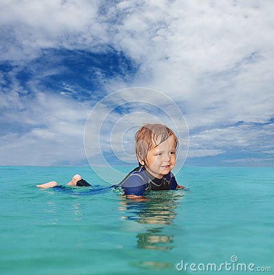 Little boy laying in the water